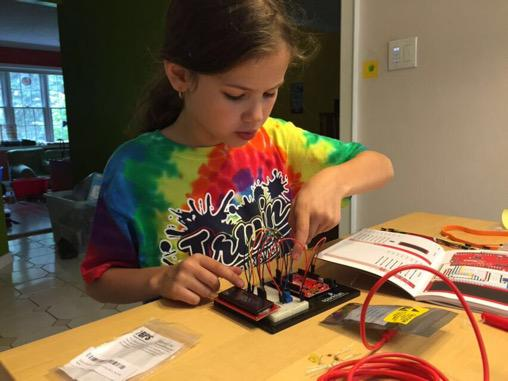My 8 year old daughter building an Arduino LCD circuit